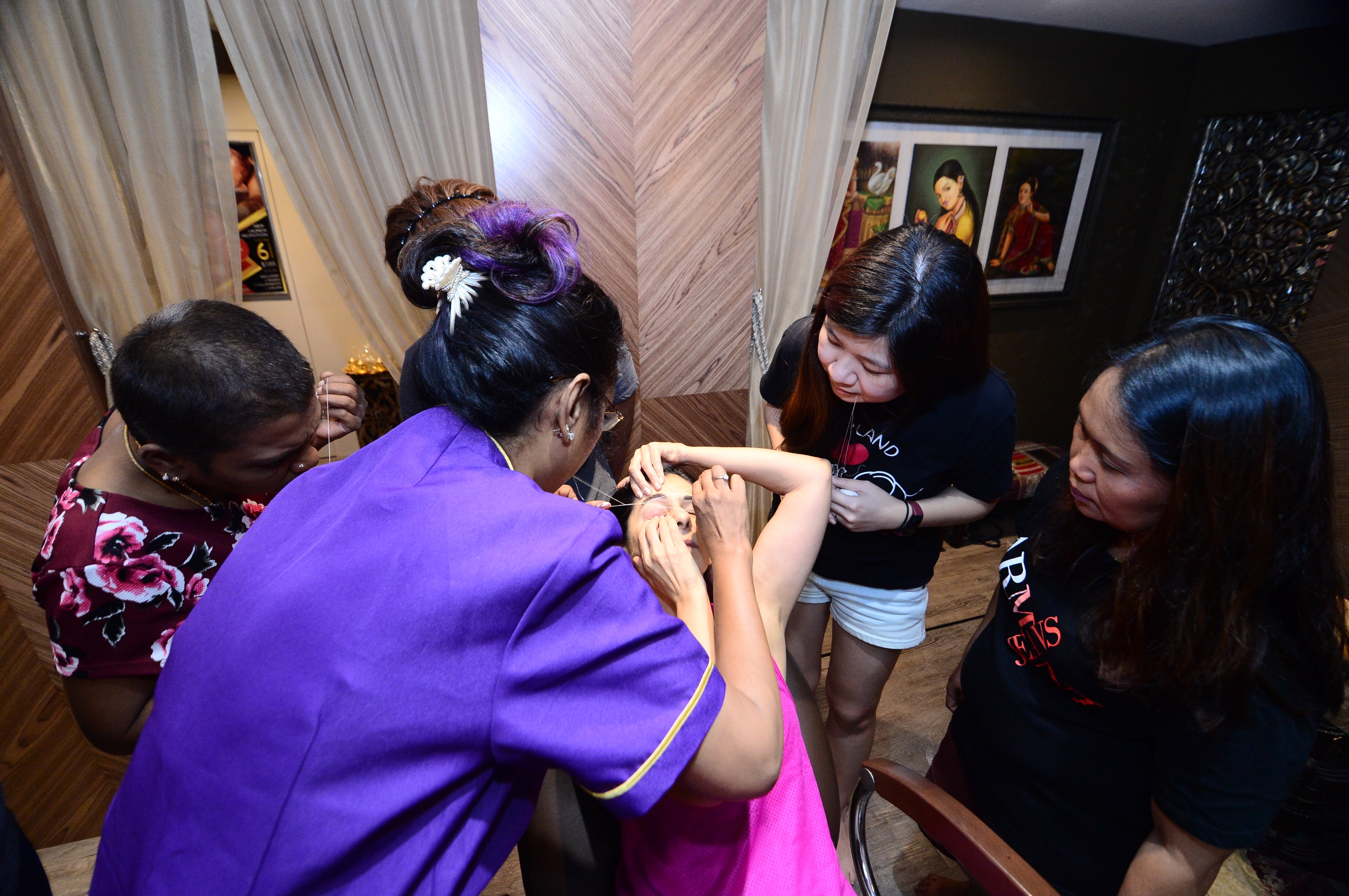 Single mothers from Yio Chu Kang Zone 7 RC were delighted to learn basics of eye brow threading from corporate volunteers from Rupini's, as they can apply the skills at home to look good and feel good.